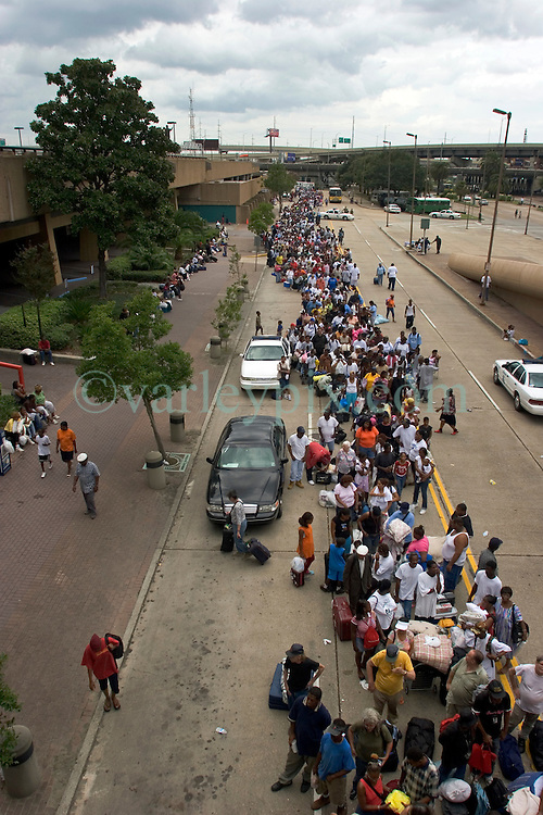 28th August, 2005. Hurricane Katrina, New Orleans, Louisiana. <br /> Shelter of last resort. Thousands of people queue to get into the Superdome on the eve of Hurricane Katrina.<br /> Photo Credit: Charlie Varley/varleypix.com