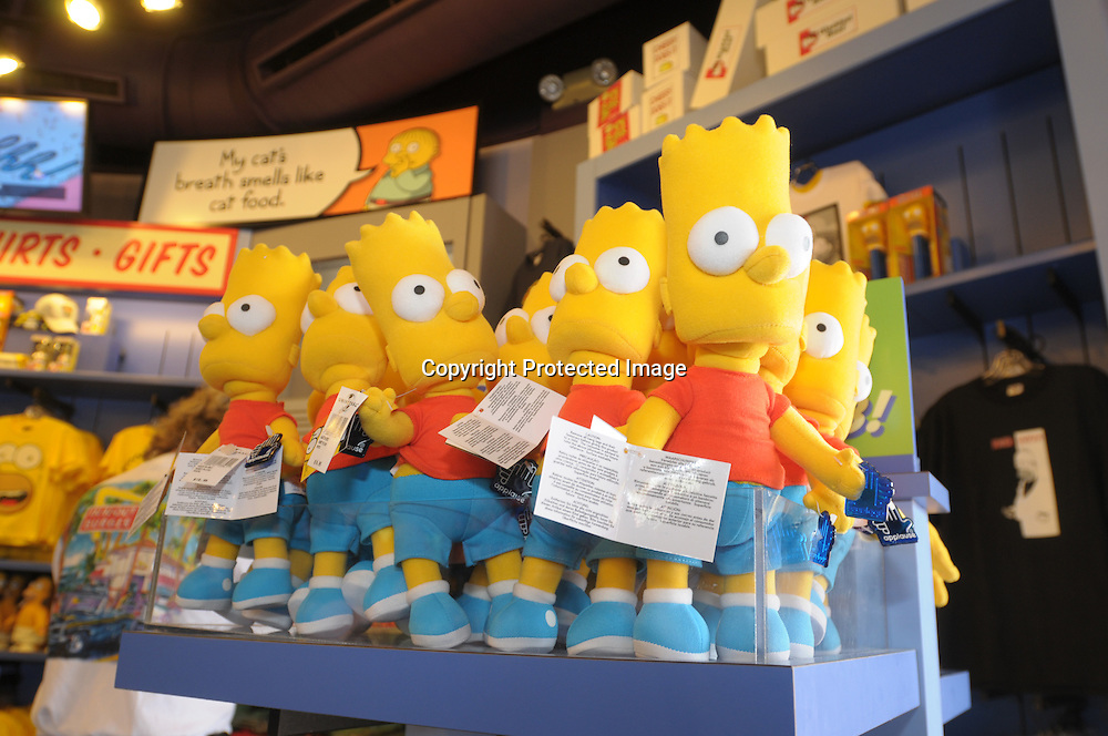 Bart Simpson dolls stand ready for purchase in the Kwik-E-Mart souvenir shop next to the newly-opened The Simpson's Ride at Universal Orlando in Orlando, Fla., Tuesday, April 29, 2008. (Photo by Phelan M. Ebenhack)