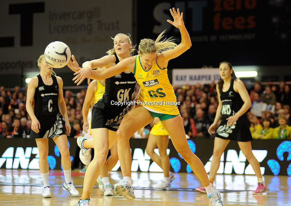 Katrina Grant of the ferns contests the ball with Catlin Bassett of the Diamonds Constellation cup netball. Silver Ferns v Australian Diamonds at ILT Velodrome, Invercargill, New Zealand. Sunday 15th september 2013. New Zealand. Photo: Richard Hood/photosport.co.nz