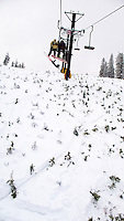 JEROME A. POLLOS/Press..Opening day for Lookout Pass Ski Area greeted skiers and snowboarders Thursday with two feet of snow at the summit but it wasn't enough to cover the trees and branches on the Idaho side of the mountain. Lookout was the first and only ski area to open so far this week.