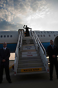 Vice President Joe Biden throws a football from the top of the stairs to Air Force 2 at Pittsburgh International Airport in  Pittsburgh, PA, July 1, 2009. (Official White House Photo by David Lienemann)