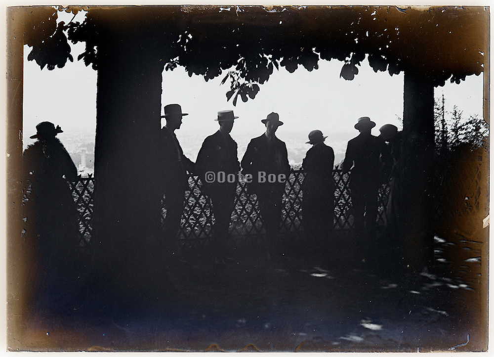 silhouetted people on promenade viewing spot early 1900s