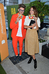 HENRY HOLLAND and ALEXA CHUNG at the annual Royal Academy of Art Summer Party held at Burlington House, Piccadilly, London on 4th June 2014.