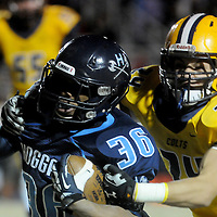 Hoggard's Keevin Thompson rushes against Cape Fear's Alec Leonard Friday November 21, 2014 at Hoggard High School in Wilmington, N.C. (Jason A. Frizzelle)