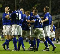Fotball<br /> Photo. Aidan Ellis, Digitalsport<br /> NORWAY ONLY<br /> <br /> Everton v Tottenham Hotspur.<br /> FA Barclaycard Premiership.<br /> 09/04/2004.<br /> Everton's Thomas Gravesen congratulates Joseph Yobo on scoring Everton's third goal