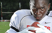 Stone Mountain High School Line Backer Markuss Eligwe puts on his most intimidating face during a portrait.