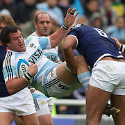 Alejandro Campos, Argentina, is tackled by Thierry Dusautoir, France during the Argentina V France test match at Estadio Jose Amalfitani, Buenos Aires,  Argentina. 26th June 2010. Photo Tim Clayton..