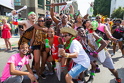 London, August 28 2017. Friends pose for a group picture on Day Two of the Notting Hill Carnival, Europe's biggest street party held over two days of the August bank holiday weekend, attracting over a million people. © Paul Davey.