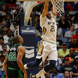Mar 18, 2018; New Orleans, LA, USA; New Orleans Pelicans forward Anthony Davis (23) dunks over Boston Celtics forward Al Horford (42) and guard Kadeem Allen (45) during the second half at the Smoothie King Center. Mandatory Credit: Derick E. Hingle-USA TODAY Sports