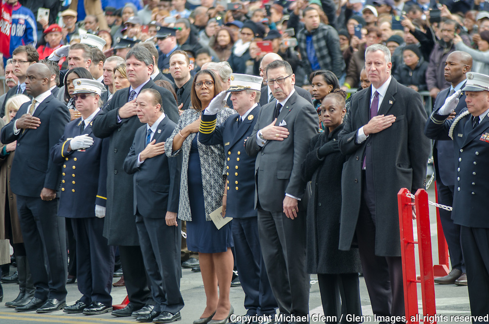25 Mar 2017 Bronx, New York United States of America // City officials and Fire Department leaders render honors while pallbearers carry the casket at the Funeral Service for EMT Yadira Arroyo at FDNYEMS Station 26 at the Saint Nicholas of Tolentine R.C.  Bronx. EMT Arroyo, who lived in the Bronx, is survived by her five sons, Jose Montes, 23; Edgar Montes, 22; Kenneth Robles, 19; Justin Robles, 16; and Isaiah Negron, 7; her parents, mother Laida Acevedo-Rosado and father Luis Arroyo, Sr.; her siblings Joell Arroyo and Luis Arroyo, Jr.; and numerous other relatives, including her stepfather Efrain Rosado and nine aunts and uncles.  Michael Glenn / Glenn Images