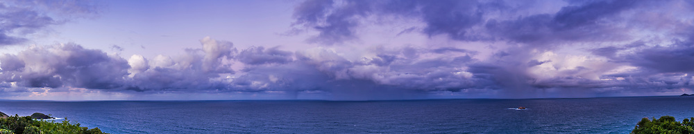 A panorama of cumulous clouds over the Pacific Ocean in the evening twilight looking east, with the contrast between the white cloud and twilight sky, and rain showers out at sea. Taken from the observing deck at the Smoky Cape Lighthouse, NSW, Australia. <br /> <br /> This is a stitch of 7 segments, each a 5-exposure HDR stack.