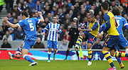 Arsenal's Theo Walcott scores  during the The FA Cup match between Brighton and Hove Albion and Arsenal at the American Express Community Stadium, Brighton and Hove, England on 25 January 2015. Photo by Phil Duncan.