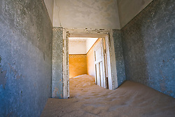 An abandoned sand-filled room in the ghost town of Kolmanskop near Lüderitz in the Namib desert, Namibia, Africa