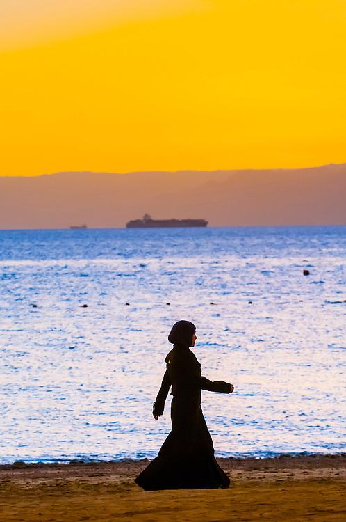 Arab women enjoying the beach at the Radisson Blu Tala Bay Resort on the Gulf of Aqaba, Red Sea, near Aqaba, Jordan