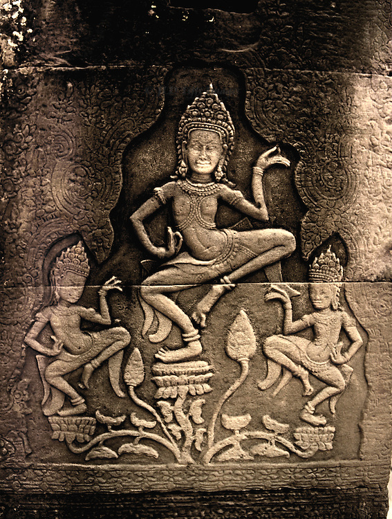 Panel showing three Apsara dancers among flourishing plants in a wall in Angkor Thom.