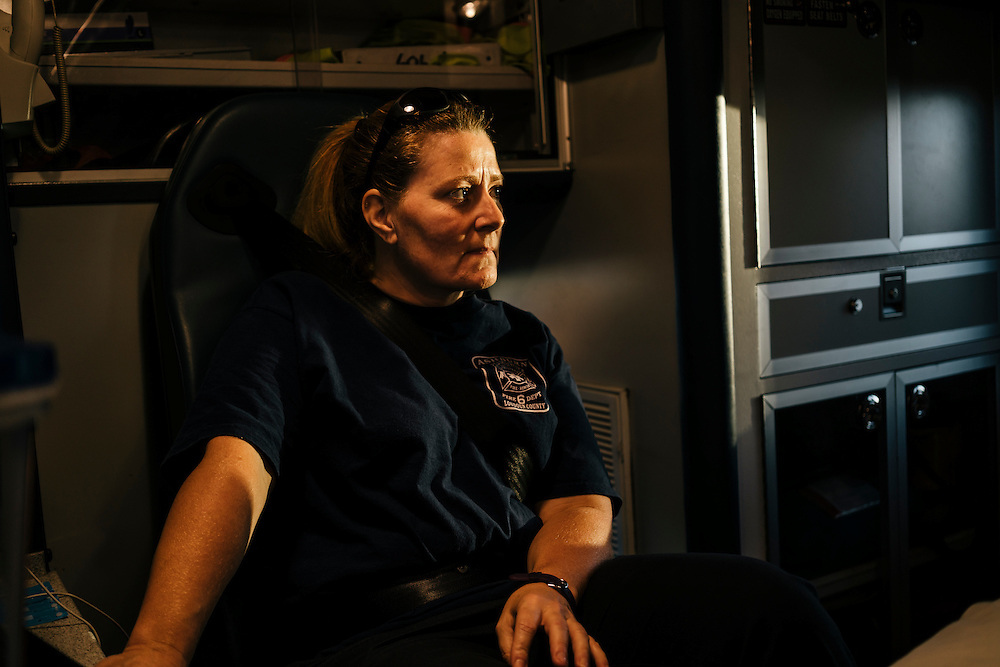 Heidi Wallner, firefighter, National Registry emergency medical technician, and safety supervisior for LSG Sky Chefs, rides in the back of the ambulance in Ashburn Virginia on Sept. 23, 2015. Wallner is a volunteer, working one night a week with other EMTs.