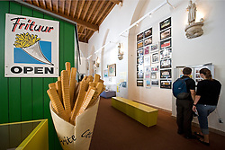 Visitors learn about the history of the Belgian Fry, at the Frite Museum in Bruges, Belgium on Tuesday, Sept. 9, 2008. (Photo © Jock Fistick)