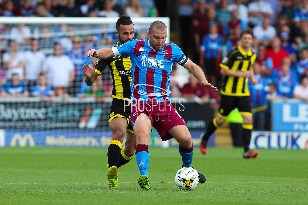 Scunthorpe's Stephen Dawson (C) holds the ball up from Robbie Weir during the Sky Bet League 1 match between Burton Albion and Scunthorpe United at the Pirelli Stadium, Burton upon Trent, England on 8 August 2015. Photo by Aaron Lupton.