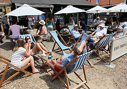 Image licensed to i-Images Picture Agency. 21/06/2014. Whitstable, United Kingdom.  Day trippers enjoying the hot weather at Whitstable in Kent.  Picture by Stephen Lock / i-Images