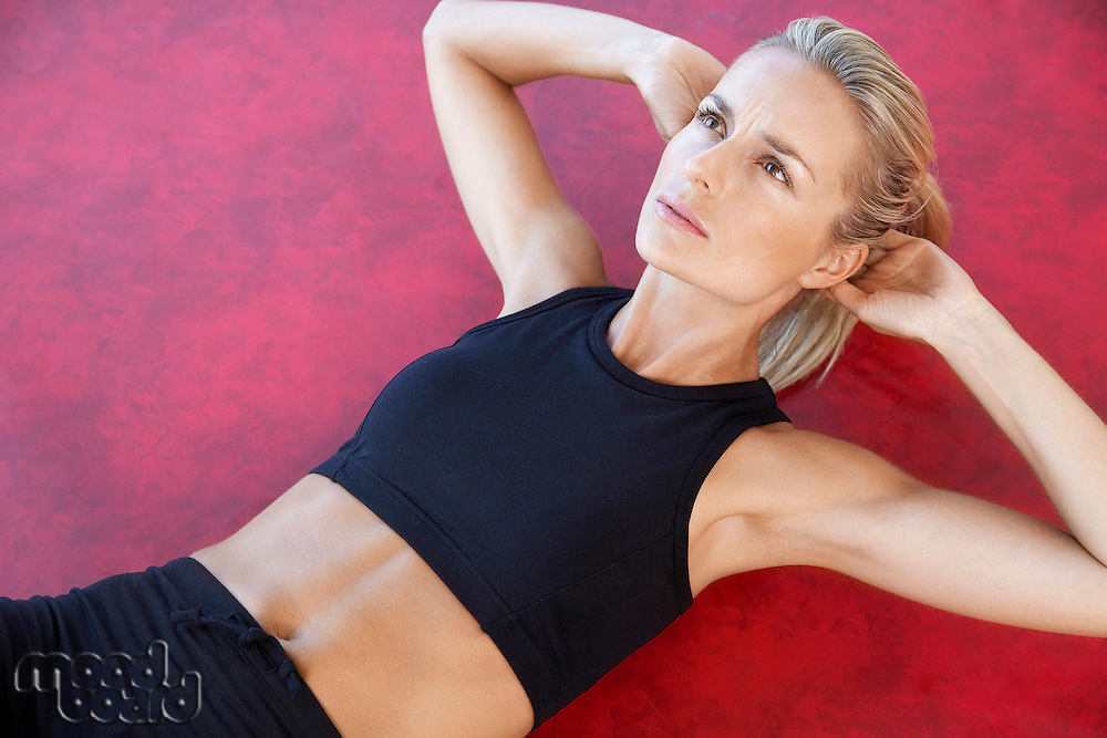 Woman Doing Sit-Ups close up high angle view