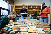MADISON, WI -JAN. 6, 2016:  Brandy Blackwood, 32, left, works on the finishing touches of a mosaic the group has created over the course of a year, Wednesday, Jan. 6, 2016. Organizers Chaplain Julia Weaver, left center, Marica Yapp, right center, and participant Dawn Hudson, 47, prepare talk and prepare for other work. Backyard Mosaic, a creative space for women with a history of incarceration, meets every Wednesday at St. John's Lutheran Church to talk and do art. Lauren Justice for Isthmus