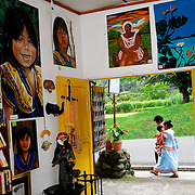 Town, of Boquete, Province of Chiriqui, country of Panama. A Ngobe indigenous family walks in front of a small gift shop. Gift shops also sell antiques to make themselves more interesting for visitors.