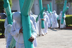 April 14, 2017 - Mexico City, Mexico - Penitents are seen Lifting a wooden cross during 'Cruciferos' religious procession on Good Friday  as part of  Mexican Holy Week celebrations on April 14, 2017 in Temascalcingo, Mexico  (Credit Image: © Carlos Tischler/NurPhoto via ZUMA Press)