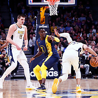 03 April 2018: Denver Nuggets guard Jamal Murray (27) drives past Indiana Pacers guard Darren Collison (2) during the Denver Nuggets 107-104 victory over the Indiana Pacers, at the Pepsi Center, Denver, Colorado, USA.