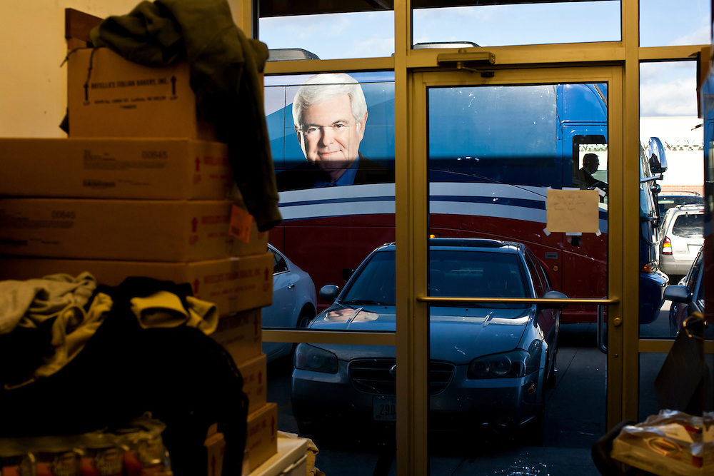 The campaign bus for Republican presidential candidate Newt Gingrich is parked outside as he meets with voters at the West Towne Pub on Sunday, January 1, 2012 in Ames, IA.