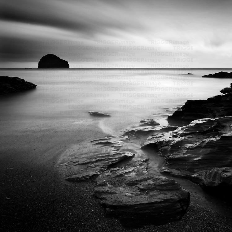 Trebarwith Strand, Cornwall with rocks on the beach with long exposure and calm sea