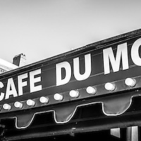Cafe Du Monde panoramic black and white picture in New Orleans Louisiana. Established on 1862, Café Du Monde is a French market coffee stand restaurant in the French Quarter of New Orleans and is famous for serving beignets and chicory coffee. Panoramic photo ratio is 1:3.