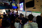 """Panel discussion attendees examine interactive boards following the talk: """"How can Madison build more great neighborhoods?"""" at High Noon Saloon in Madison, Tuesday, November 7, 2017."""