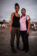 UK celebrity Myleene Klass (left) poses for a portrait with health worker Girlie Mercado, 54, in an urban slum and inhabited cemetery in Paranaque City, Metro Manila, The Philippines on 18 January 2013. Photo by Suzanne Lee for Save the Children UK