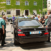 MILAN, ITALY - JULY 16: George Clooney leaves in his car Milan's law courts after testifying against three individuals accused of fraudulently using his name to promote a fashion label at Palazzo di Giustizia on July 16, 2010 in Milan, Italy. George Clooney testified as a civil plaintiff during the trial against the individuals running fashion label GC Exclusive by George Clooney.   (Photo by Marco Secchi/Getty Images)