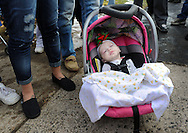 LEVITTOWN, PA -  DECEMBER 28:  Hannah Rose Ginion, whose battle with Krabbe disease inspired a law to update Pennsylvania's newborn screening list, died December 28, 2014. In this file photo, Hannah Rose Ginion rests in her carrier as a crowd sings Christmas carols at the Pizzullo home December 21, 2013 in Levittown, Pennsylvania. Hannah was born with Krabbe, a genetic disorder that affects both the central and peripheral nervous systems. The family is fighting to make newborn screening for the disorder a state law. (Photo by William Thomas Cain/Cain Images)