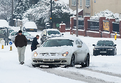 © under license to London News Pictures.  18/12/2010. A car stuck in heavy snow in Datchet, Berkshire today (18/12/2010).  Severe weather is expected to hit the whole of the UK this weekend. Photo credit should read Sam Long/ London News Pictures