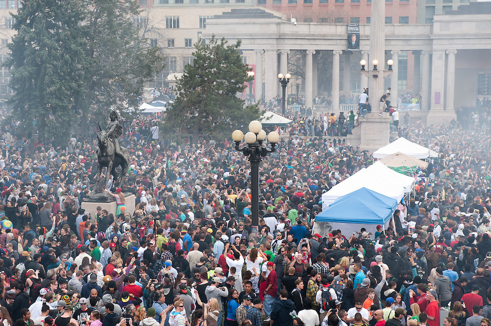 Smoke rises at 4:20 as thousands of participants smoke marijuana at the Civic Center Park rally in Denver.