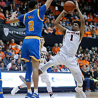 Oregon State's Stephen Thompson Jr. (1) tries to shoot over UCLA's Lonzo Ball (2) during the first half of an NCAA college basketball game in Corvallis, Ore., on Friday Dec. 30, 2016. (AP Photo/Timothy J. Gonzalez)