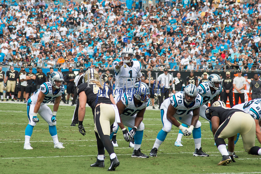 Cam Newton(1) points out defenders in the New Orleans Saints 34 to 13 victory over the Carolina Panthers.