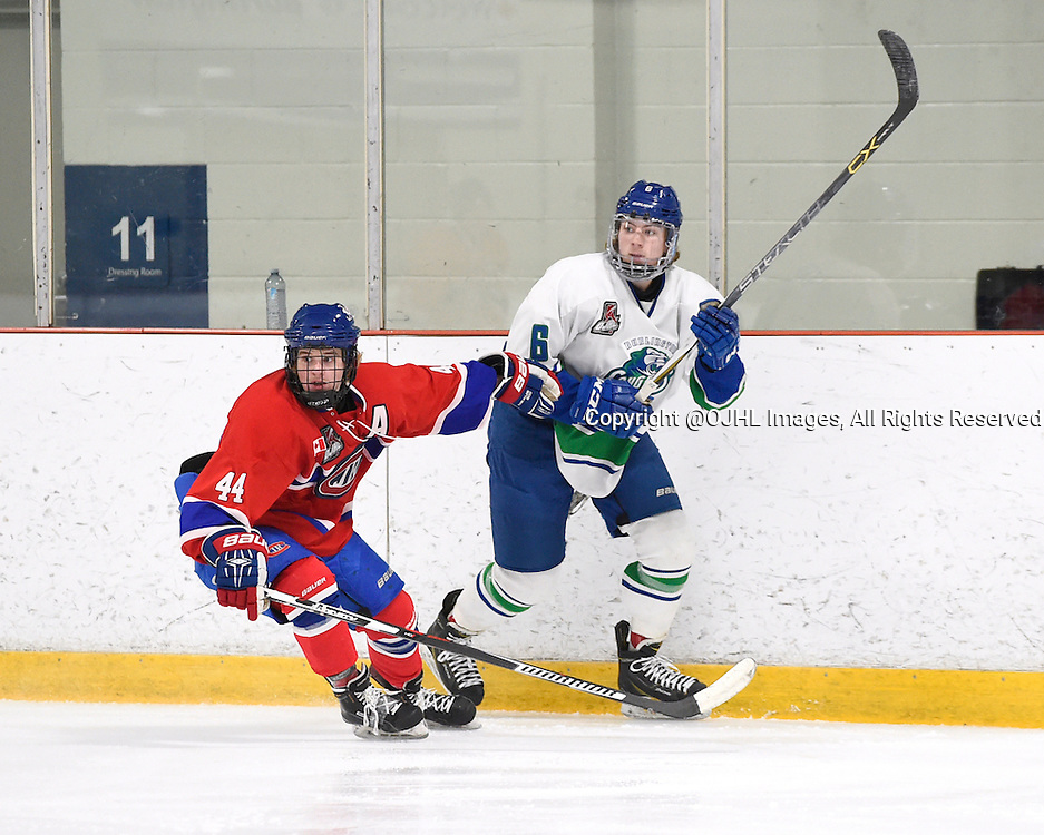 BURLINGTON, - Mar 2, 2016 -  Ontario Junior Hockey League game action between Burlington Cougars and the Toronto Junior Canadians. Game 1 of the first round playoff series at the Appleby Ice Centre, ON. Nicholas Jarzabek #44 of the Toronto Jr. Canadiens and Zac Herrmann #6 of the Burlington Cougars follows the play during the second period.<br /> (Photo by Andy Corneau / OJHL Images)