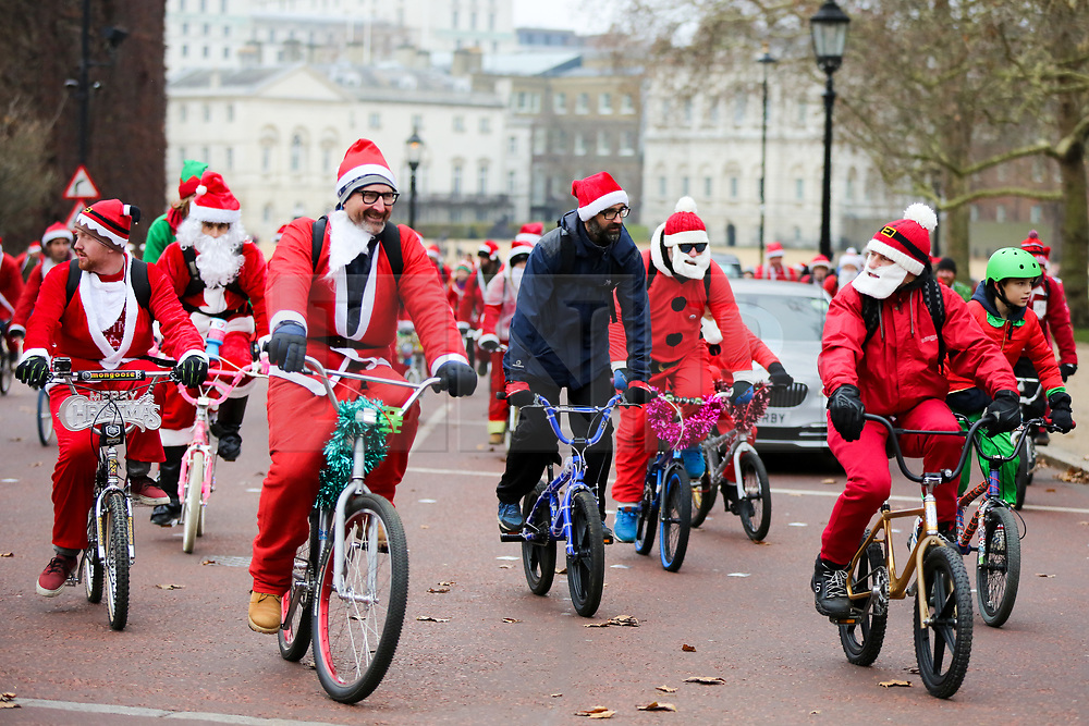 © Licensed to London News Pictures. 15/12/2018. London, UK. Hundreds of people take park in BMXLife's London Santa Cruise stopping at Horse Guards Parade before cycle through London and raise awareness and money for Evelina London Children's Hospital (ECHO), for children with heart conditions. The annual event began four years ago after Stephane Wright's son Tommy, suffered a heart attack and spent time at Evelina London. Tommy was only 6 months old when he suffered a heart attack and nearly died. He was admitted to Evelina London Children's Hospital in October 2014. Tommy spent four weeks in Paediatric Intensive Care and the High Dependency Unit. Fortunately Tommy recovered well and was able to return home to his parents, Stephane and Karen, and sister's Caitlin and April. However, Tommy will require further operations as he grows up, so will be returning to the Evelina London in time.<br /> Photo credit: Dinendra Haria/LNP