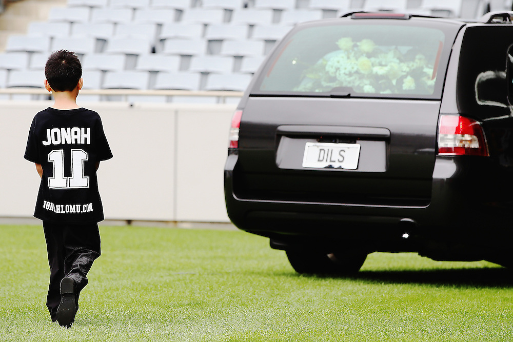 Son of Jonah Lomu, Dhyreille Lomu follows the hearse as it departs the Remembering former All Black Jonah Memorial Service, Eden Park,, Auckland New Zealand, Monday, November 30, 2015. Credit:SNPA / Getty, Hannah Peters **POOL**