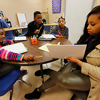 THOMAS WELLS | BUY at PHOTOS.DJOURNAL.COM<br /> Joyner Elementary School students Iyana Jones, from left,  Jaihlyce Moore and Makhia Bogan work with Kelly Orr on their literacy skills as part of a school wide program to help student move onto the fourth grade.
