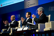 Yoshio Kono, president and CEO of  Norinchukin Bank (2L), applauds with Michel M. Lies, group CEO of Swiss Re, Ltd. (R), and Toru Hashimoto, president and CEO of the Development Bank of Japan Inc., following a special session on Japan's reconstruction following last year's earthquake and tsunami during the International Institute of Finance conference in Tokyo, Japan on 11 Oct. 2012. Photographer: Robert Gilhooly