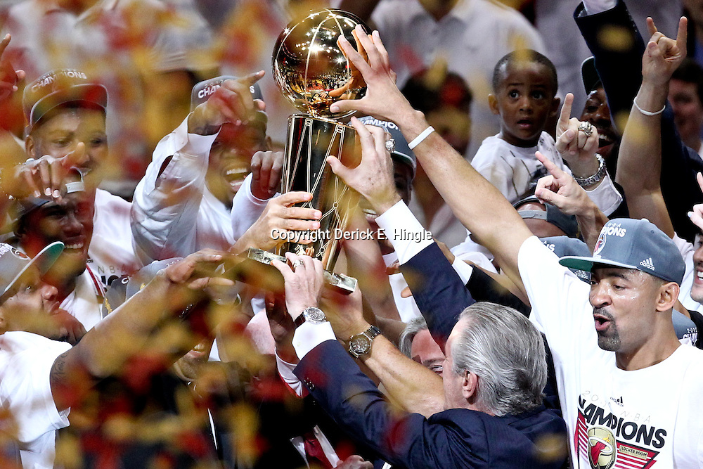 Jun 21, 2012; Miami, FL, USA; Miami Heat president Pat Riley celebrates along with players with the Larry O'Brien Trophy after winning the 2012 NBA championship against the Oklahoma City Thunder at the American Airlines Arena. Miami won 121-106. Mandatory Credit: Derick E. Hingle-US PRESSWIRE