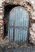 A door of an abandoned  building damaged by the earthquake in the historical center city. On 6 April 2009 a strong earthquake hit the city of L'Aquila, in the central Abruzzo region of Italy, leaving 308 dead and tens of thousand homeless. 4  years after In the historical center of the city few signs of reconstructions could be seen. On the other hand the effects of the of abandonment add up to the destruction of the quake. .