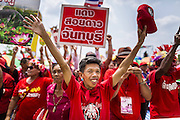 April 6, 2014 - Bangkok, Bangkok, Thailand - <br /> <br /> Red Shirts Rally in Bangkok Suburbs<br /> <br />  Red Shirt supporters cheer for the government during a rally in the Bangkok suburbs Sunday. Red Shirts and supporters of the government of Yingluck Shinawatra, the Prime Minister of Thailand, gathered in a suburb of Bangkok this weekend to show support for the government. The Thai government is dealing with ongoing protests led by anti-government activists. Legal challenges filed by critics of the government could bring the government down as soon as the end of April. The Red Shirt rally this weekend was to show support for the government, which public opinion polls show still has the support of most of the electorate. <br /> ©Exclusivepix