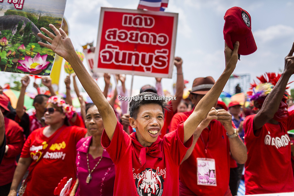 April 6, 2014 - Bangkok, Bangkok, Thailand - <br /> <br /> Red Shirts Rally in Bangkok Suburbs<br /> <br />  Red Shirt supporters cheer for the government during a rally in the Bangkok suburbs Sunday. Red Shirts and supporters of the government of Yingluck Shinawatra, the Prime Minister of Thailand, gathered in a suburb of Bangkok this weekend to show support for the government. The Thai government is dealing with ongoing protests led by anti-government activists. Legal challenges filed by critics of the government could bring the government down as soon as the end of April. The Red Shirt rally this weekend was to show support for the government, which public opinion polls show still has the support of most of the electorate. <br /> &copy;Exclusivepix