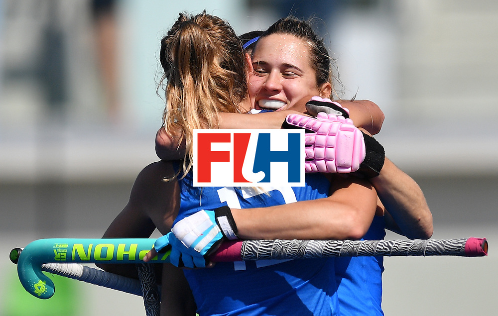 Argentina's Martina Cavallero (R) celebrates scoring with her team-mate Delfina Merino during the women's field hockey Argentina vs India match of the Rio 2016 Olympics Games at the Olympic Hockey Centre in Rio de Janeiro on August, 13 2016. / AFP / Carl DE SOUZA        (Photo credit should read CARL DE SOUZA/AFP/Getty Images)