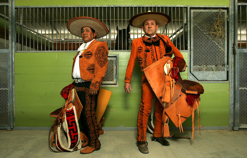 Pepe Jose Zarate (left) and Arturo Montes work as Charros at Mid Valley Stables outside of Mercedes, Texas.  The pair work with the stables' horses, training them in dressage and traditional Mexican moves like the Spanish Walk.